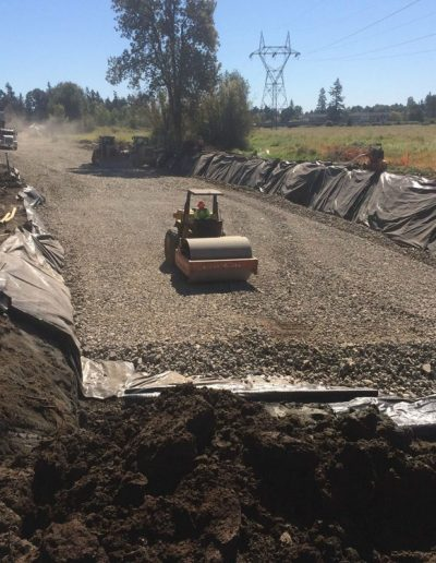 roller-flattening-gravel-ODOT-Kinsman-Road-project-Oregon